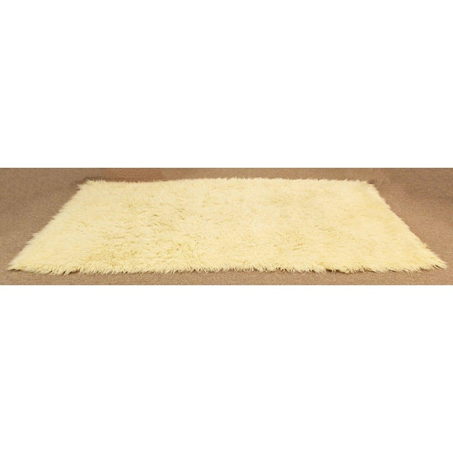 For your consideration is a fabulous, white flokati shag, hand woven wool area rug or carpet, circa the 1970s. In...