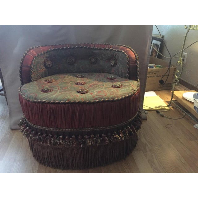 """This Moroccan style stool/ottoman, which is skirted with a 6"""" fringe, topped with 6"""" of pinched pleats, features an arched..."""