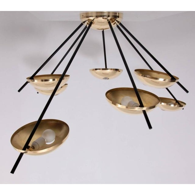 Huge brass sputnik lamps, which can be used as flush mounts or wall lamps. The lamps are attributed to Stilnovo and they...