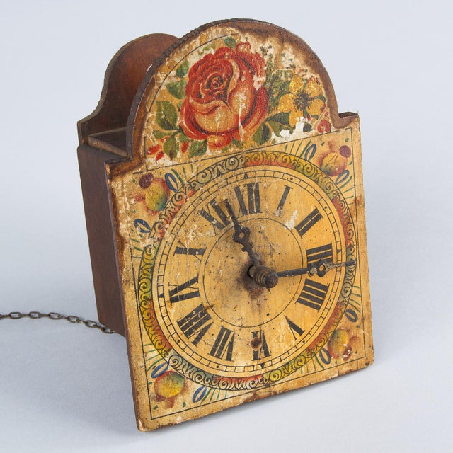 A 19th century decorative (non-operable) wooden clock from the Alsace Region, circa late 1800s. Rustic wooden housing...