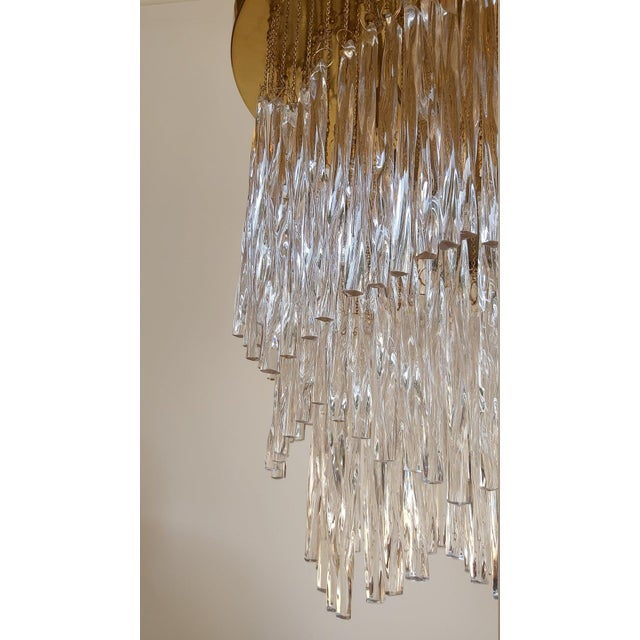 An Excquisit large Italian Mid-century handblown Venetian glass chandelier composed of twisted rods of glass suspended...