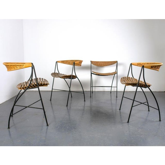 Dining set by Arthur Umanoff for Raymor. All pieces original to the set. USA, circa 1950s. Table: 42.5 D x 29.5 H inches....