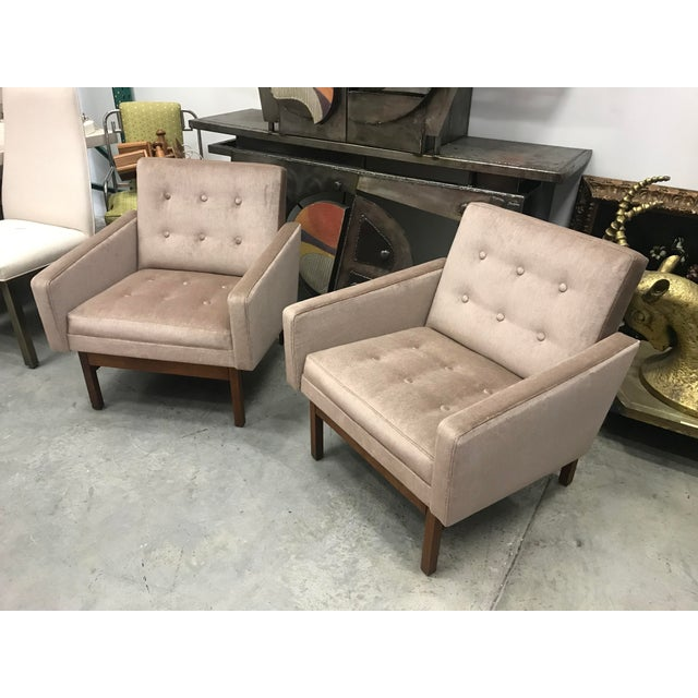 Beautiful pair of Danish arm chairs in very good condition. Very stylish look with clean walnut bases.these chairs are in...