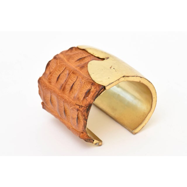 This studio signed Nada Sawaya New York hand hammered brass and brown crocodile leather wide cuff bracelet is very...