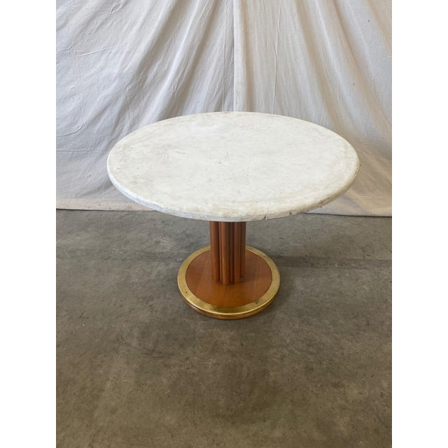 Super chic mid century round stone top dining / game table with pedestal base. This stylish table consists of a lovely...
