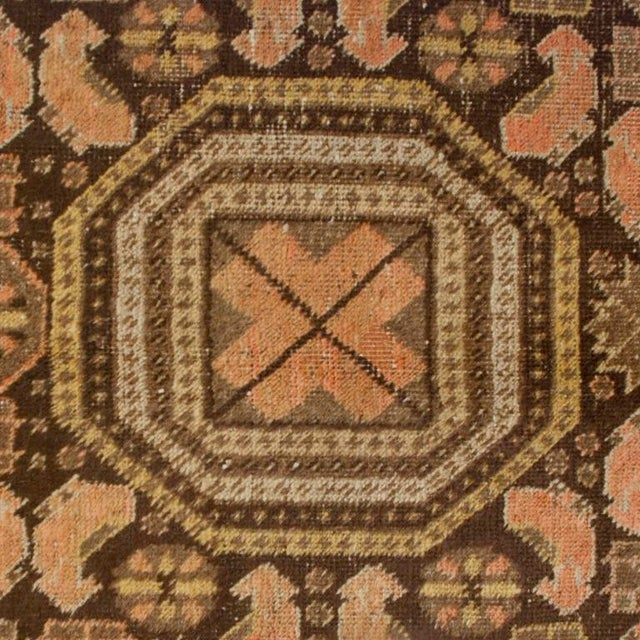 A 19th century Central Asian Khotan carpet with three central octagonal medallions surrounded by a field of stylized...