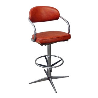 Chromcraft Mid-Century Orange Vinyl Swivel Chair For Sale