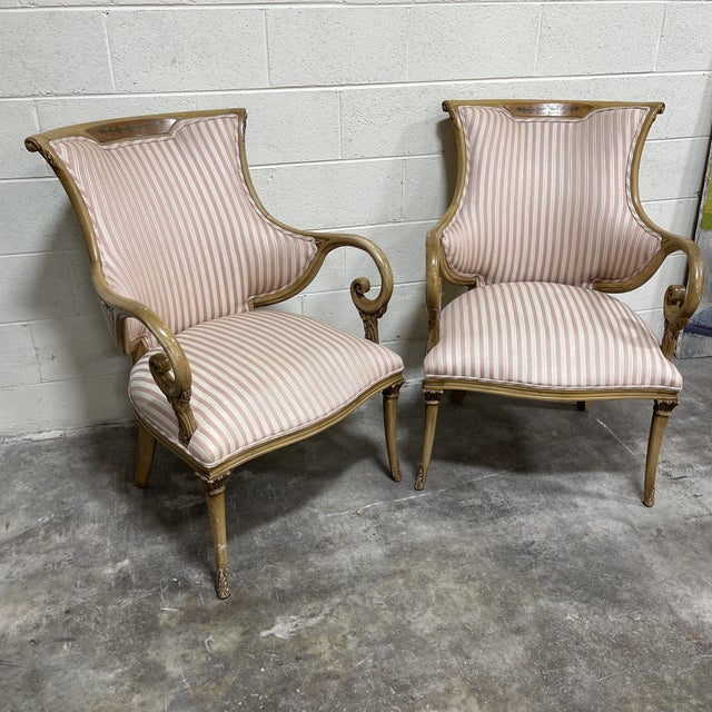 This is a fantastic pair of sculptural wood frame, French style arm chairs with scrolled ornate arms. Wood appears to be...