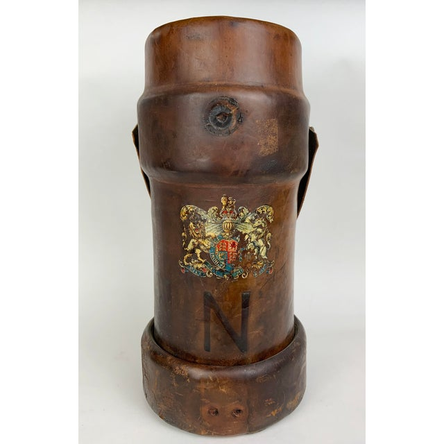 This 19th century Leather Ammunition bucket has a stunning hand painted Heraldic Crest featuring a fierce Lion and a...