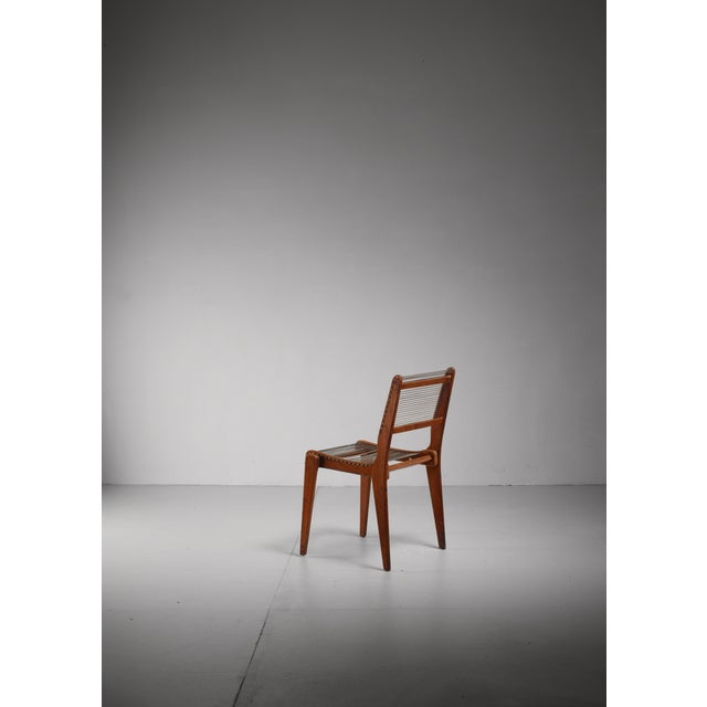 An American studio crafted side chair made of wood with a seating and backrest made of woven string. Very elegant side chair.