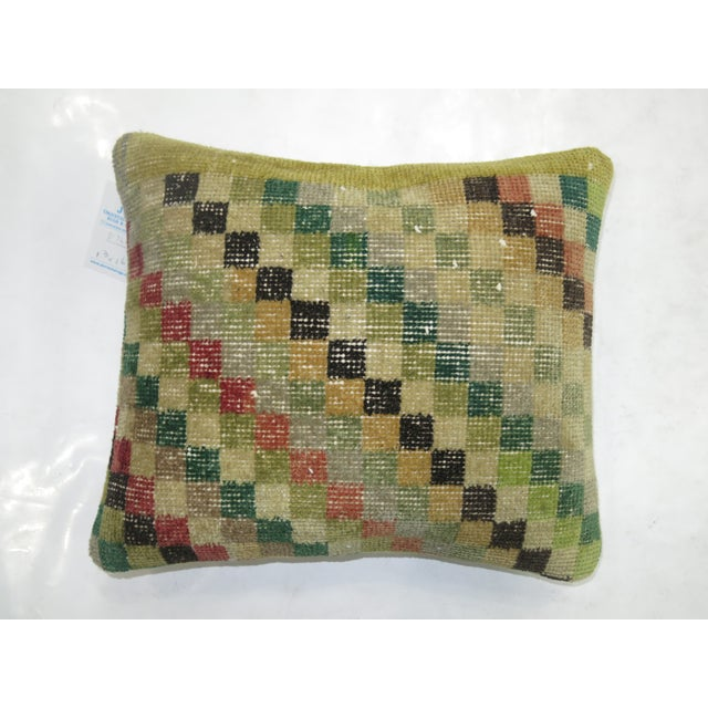 Pillow made from a vintage turkish art deco rug with a cotton back. Zipper closure and foam insert provided.