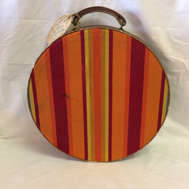 Very vibrant striped round zippered carry on suitcase. Hat box style. Has a zipper that goes almost 360 degrees. The...