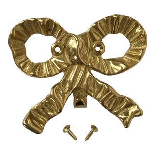 Vintage Large Solid Brass Bow Wall Hook For Sale