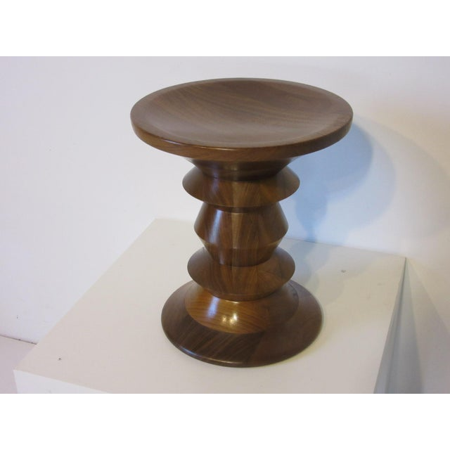 A beautifully crafted walnut stool with nice turned wood design used as a stool for extra seating or for an end / side...