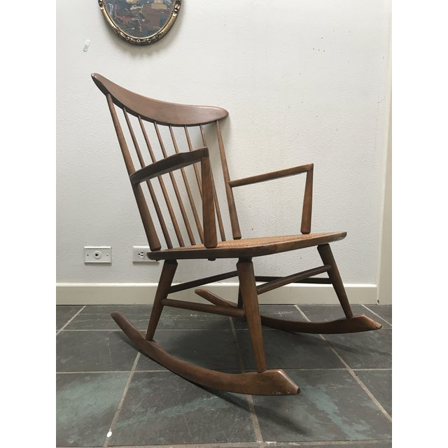 Vintage danish walnut rocking chair with a cane seat, made in Denmark. Fit for a stylish nursery yet sophisticated enough...