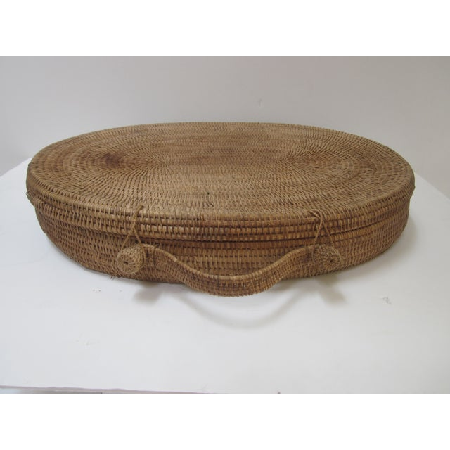 "Vintage oval lidded woven storage basket. An impressive large basket - measures about 23 1/2 x 18"", not including the..."