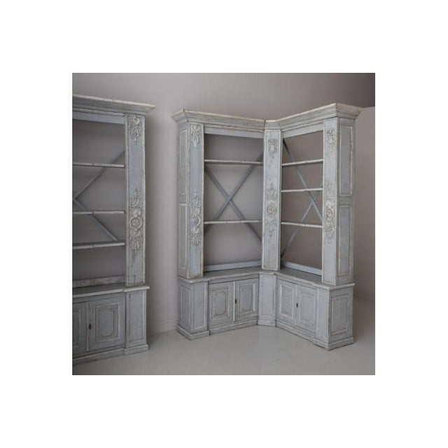 A rare pair of corner bookcases in the Louis XVI style. This piece marries the original 19th century construction of the...