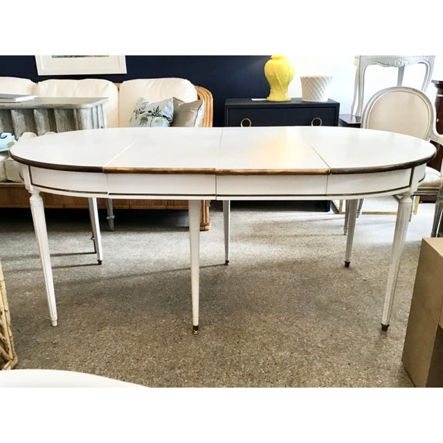 Fantastic French Louis XVI oval dining table with 2 leaves. This table can also be a round dining table without the...