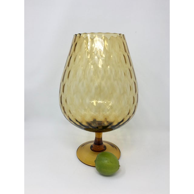 This footed vase is similar in shape to a brandy snifter or goblet. It's just larger. It's large enough for even...