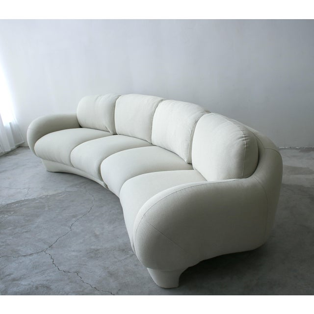 Uniquely different 2 piece post modern sofa. A large curved piece, perfect for floating in a room. Sofa has gorgeous,...