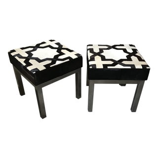 Pair of Modern Geometric Back and White Cowhide Ottomans For Sale