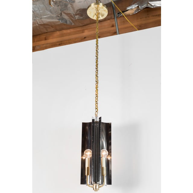 Sculptural, restored Mid-Century Modern pendant with reflective qualities and modern style. Restored, the steel is...