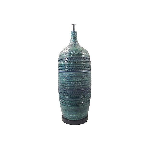 Bitossi turquoise blue large ceramic lamp with faint green accents and an incised, geometric design on a textured body....