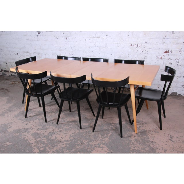 Offering a rare and outstanding mid-century modern dining set designed by Paul McCobb for his Planner Group line for...