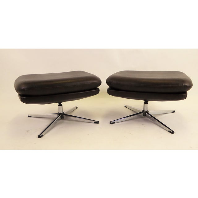 Pair of 1970s Overman stools / benches or ottomans in brown leatherette vinyl. They have four point star bases and swivel....
