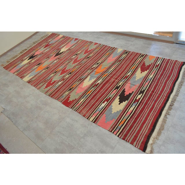 Material: Made of hand spinning wool on wool and natural dyes. Condition: original rug is used, in very good condition....