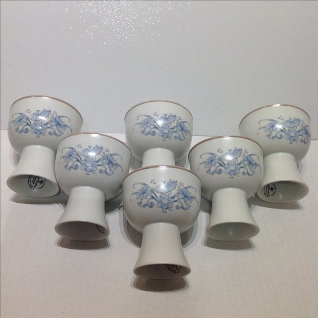 Offered is a scarce vintage set of stoneware goblets by Royal Doulton featuring a light blue floral motif on front and...
