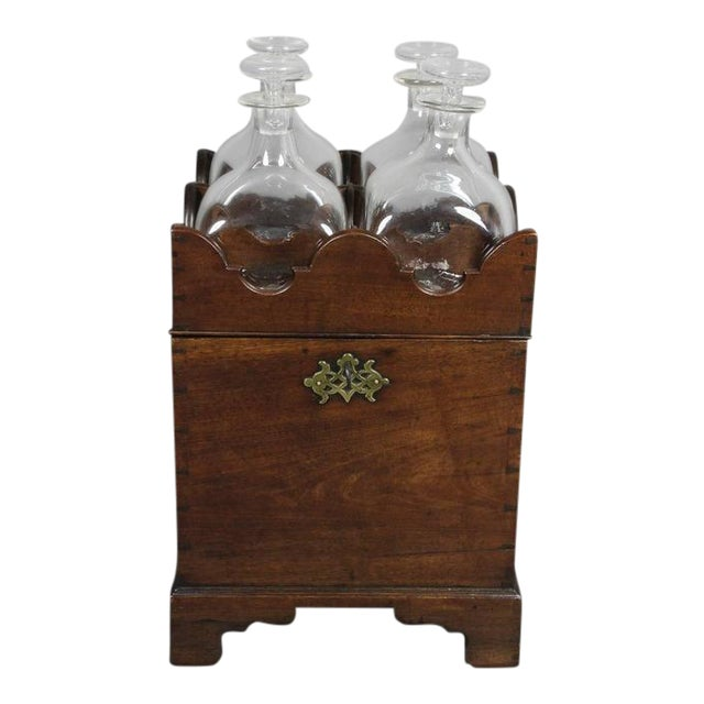 Square top with compartments for four bottles over a dovetailed case opening to storage for four bottles, bracket feet....