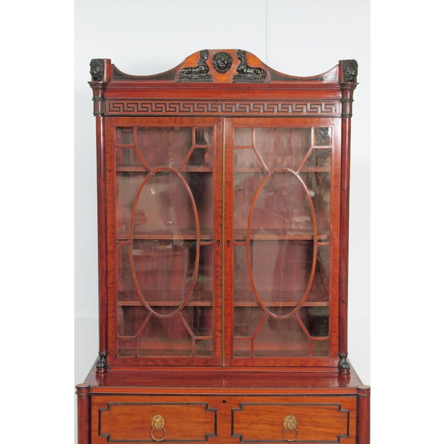 English Regency period mahogany and satinwood two-piece secretary cabinet. Pine secondary wood. Top section having a...