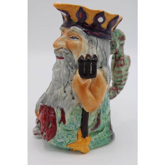 THE COOLEST TOBY JUG we have come across! This English Staffordshire Toby Jug depicts a charming Father Neptune holding a...