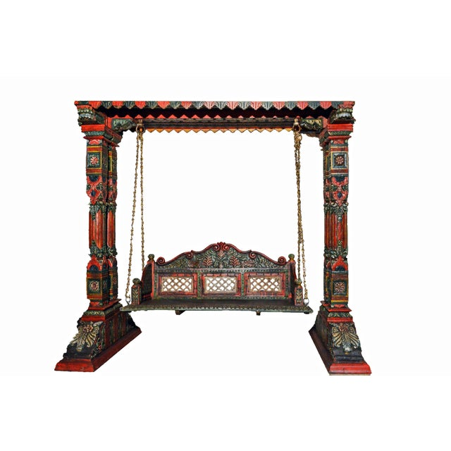 This Royal Indian Jhula Swing is exquisitely handcrafted and painted by Skilled Indian Craftsman. This crafted wooden...