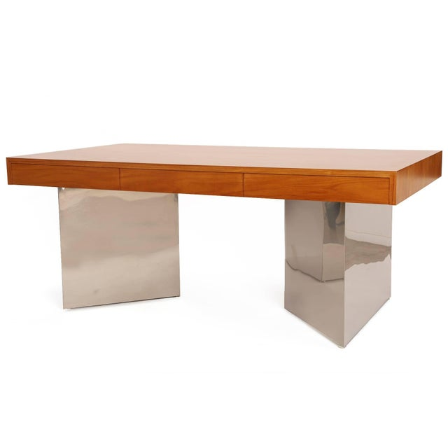 Teak and polished steel desk by Pace, circa early 1970s. This example has an exquisitely grained teak top with three inset...