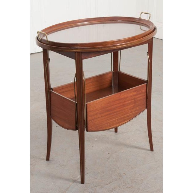 A wonderful mahogany tea table, circa 1910, from France. This early 20th century piece is in great antique condition, with...