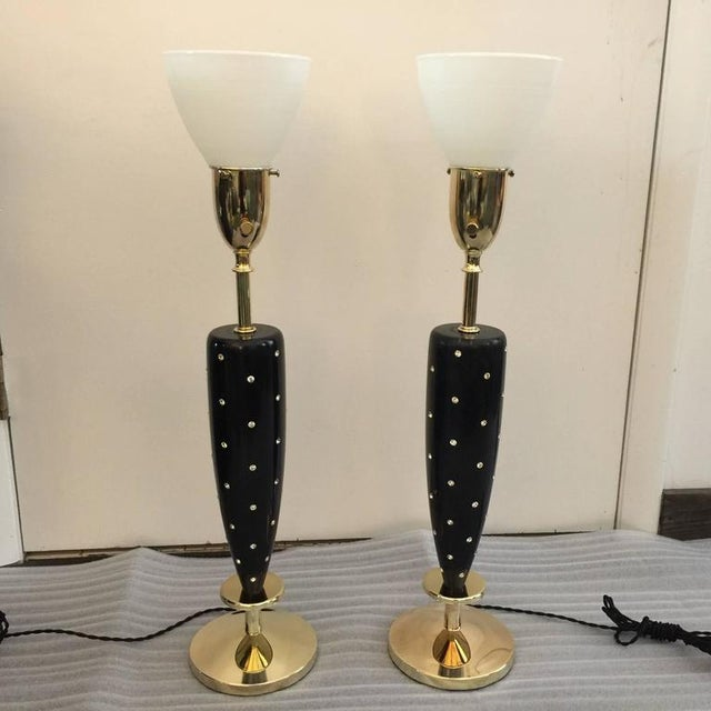 These wonderful Mid-Century table lamps by Rembrandt have been rewired and polished. The black lacquered wood is original...