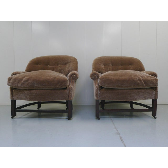 These barrel-shaped club chairs were manufactured circa 1950s. They are very comfortable with soft, plush cushions, tufted...