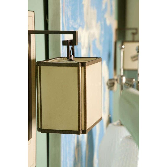 Paul Marra Leather Back Sconce with Oiled Paper Shade, shown in cream leather.