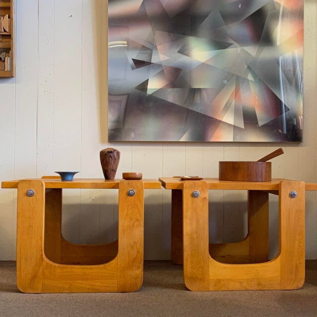 Fun and friendly curvy pine end tables with chrome nuts and bolts. These 1970s handmade studio craft tables evoke a true...