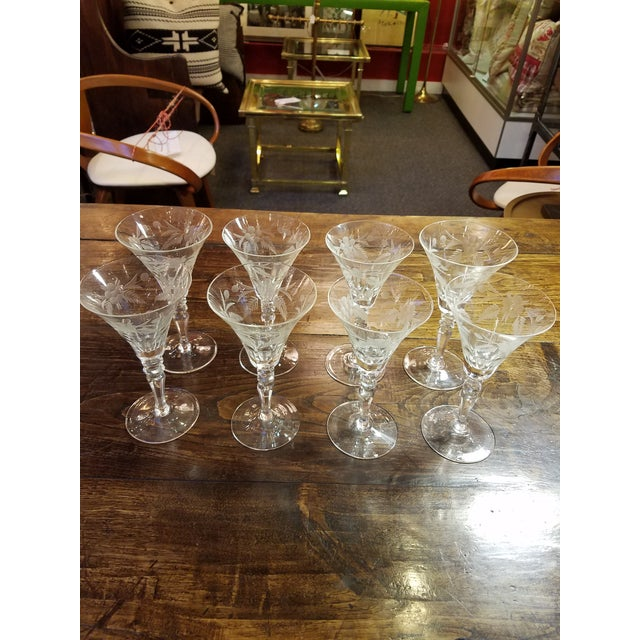 Wonderful elegent 1920's stemmed glasses with panel cut and floral engraved tops. Perfect for small wines, dessert wine,...