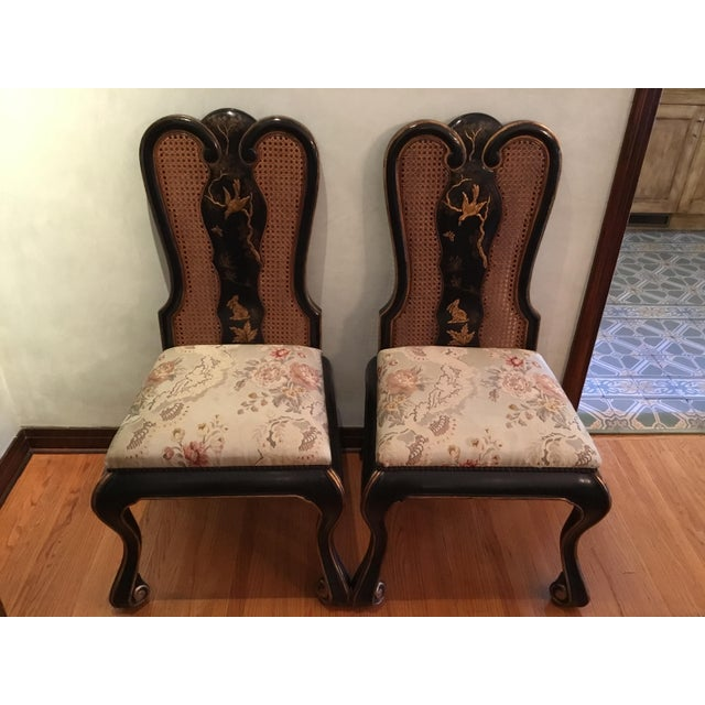 Total of 10 chairs, 2 arm chairs and 8 with out arms. The hand painted Chinoiserie and black crackle finish is exquisite....