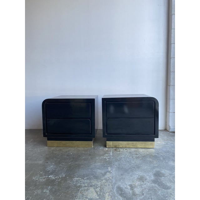 Black laminate with black lacquer surface nighstands. These sit on brass plated plinth bases. Nighstands base on right...