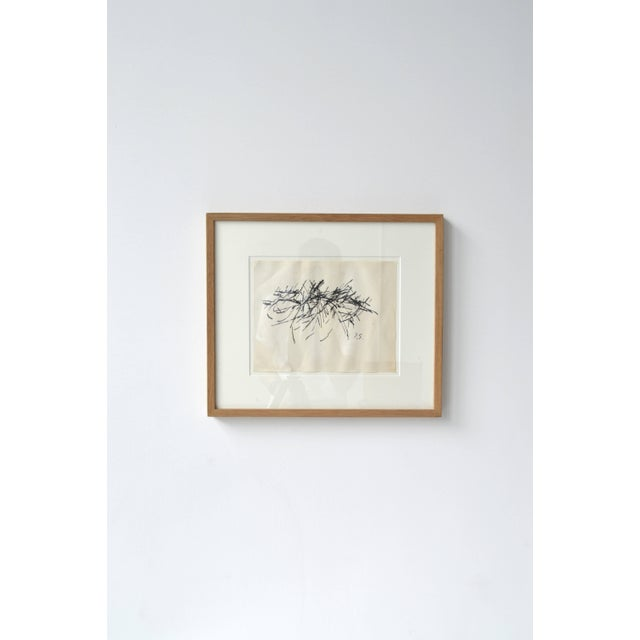 Black and white abstract drawing by French artist Jacques Germain framed in a natural light wood frame. Jacques Germain...