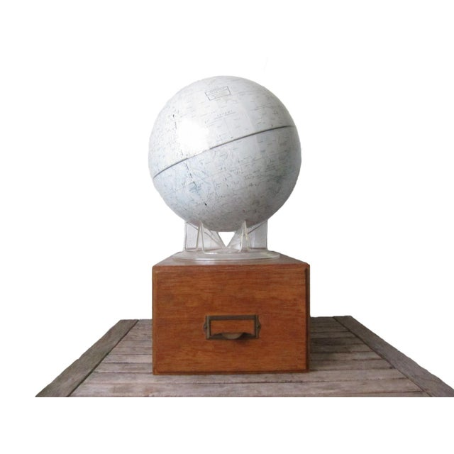 "This lunar globe was likely made in the 1970s by Replogle. It measures 12"" across and features the topography of the moon,..."