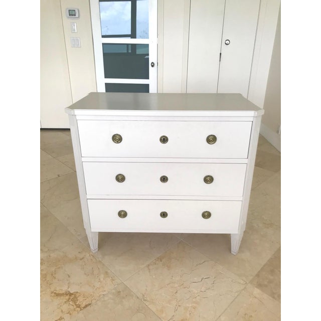 Elegant Swedish vintage chest of drawers. Fitted with three large spacious drawers. The chest features canted corners a...