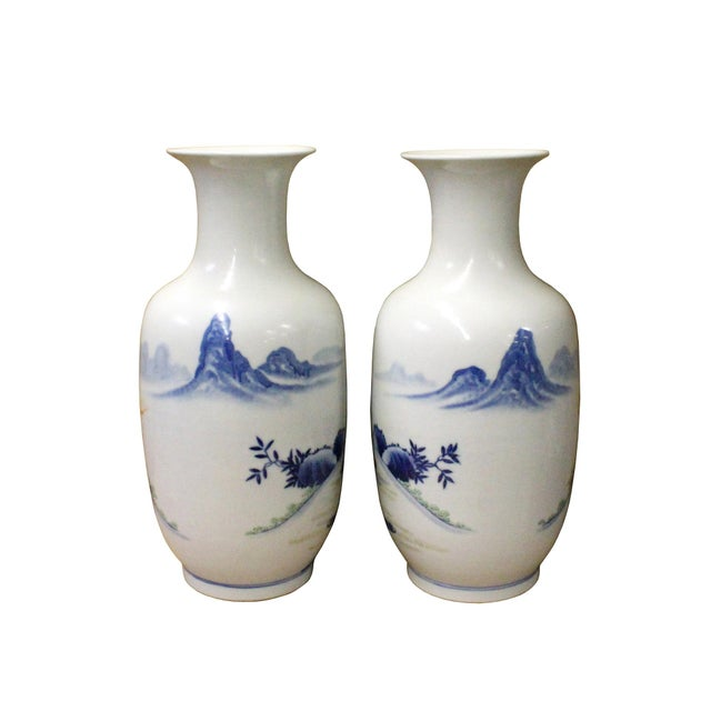 This is a pair of Chinese decorative ceramic pottery vases handmade with colorful ancient people gathering scenery...