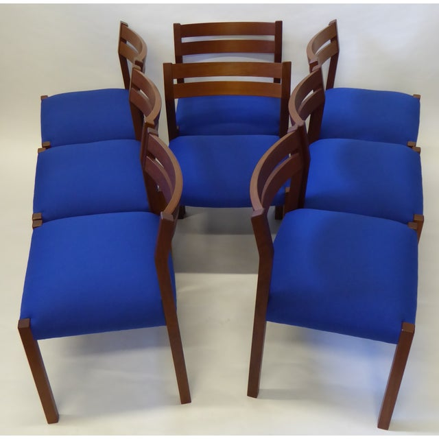REDUCED FROM $4,800. From Denmark, solid teak with a warm patina and blue Kvadrat Hallingdal 65 upholstered seats...