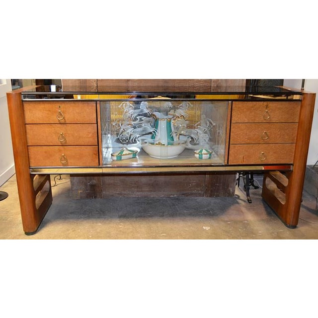 A classic Italian late deco, early mid century case piece. This beauty has all the bells and whistles from burled wood...